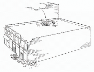 The failure of parapets, one of the most common types of unreinforced masonry building damage.