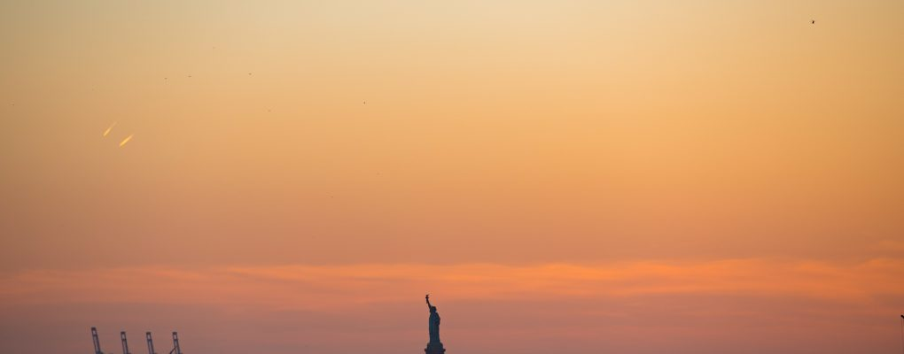 The Statue of Liberty at sunset as seen from a NYC Ferry docked at the DUMBO stop on Monday, March 26, 2018. Benjamin Kanter/Mayoral Photo Office.