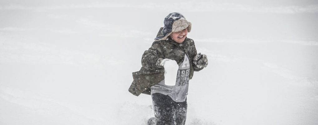 Child playing in the snow. Courtesy of Mayor's Office of Photography.