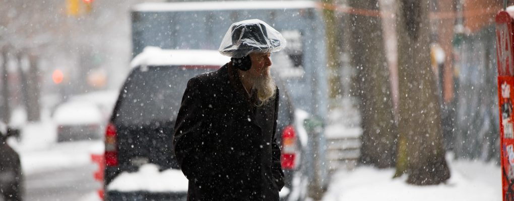 Man walking in the snow. Courtesy of Mayor's Office of Photography.