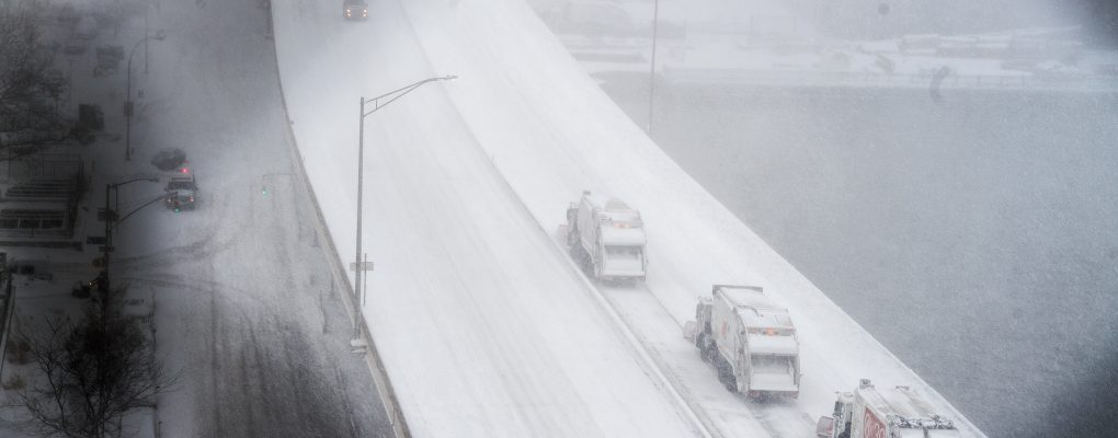 DSNY trucks on the highway. Courtesy of Mayor's Office of Photography.